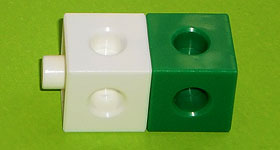 Two adjoining cubes: one white, one green.