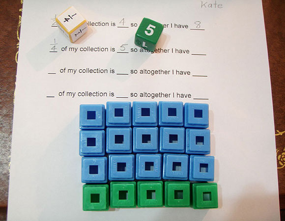 Two dice, one die displaying 1/4 and the other 5. One set of 5 cubes in one colour, three sets of 5 cubes in another colour to make a total of 20.