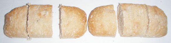 Each loaf is cut into three equal pieces and the six pieces arranged as three groups of two.