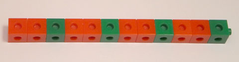A line of coloured cubes consisting of two red cubes and a green cube repeated four times.