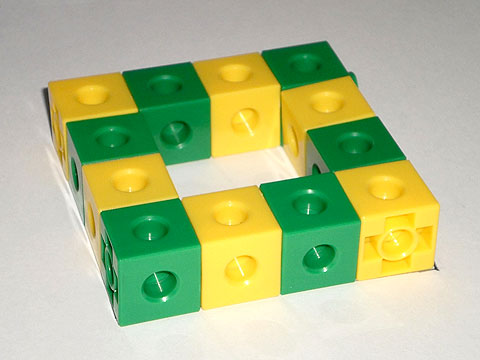A hollow square, with each side consisting of a line of green-yellow-green-yellow cubes.