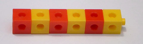 Six cubes, alternating in colour between red and yellow.